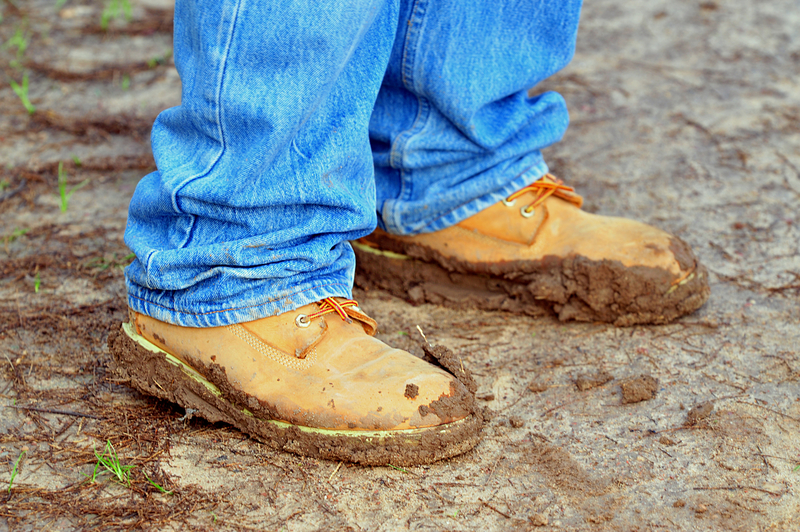 walking shoes coated in mud